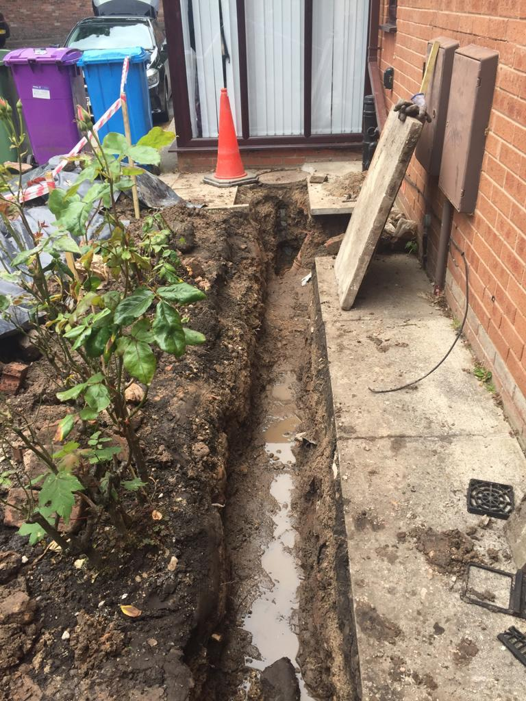 Trench that has been dug ready to lay a new drain.