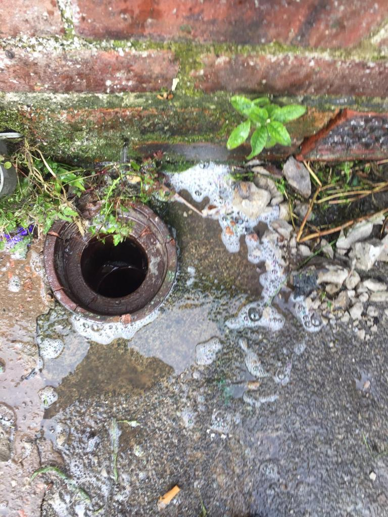 Outside drain that has been unblocked after a bad blockage.