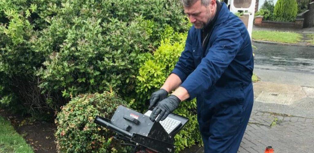 Engineer performing CCTV drain survey in Liverpool